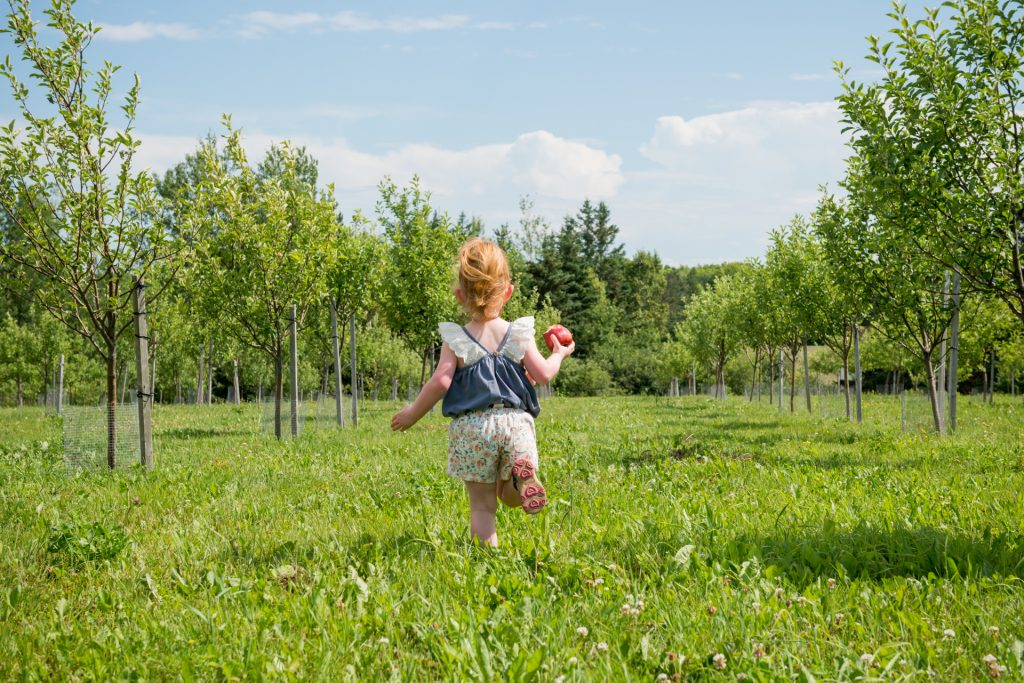 Riverdale Orchard girl in orchard